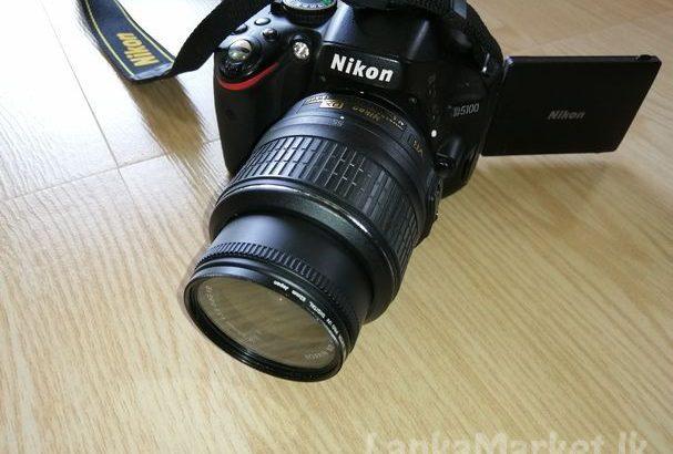 Nikon D5100 DSLR camera with Nikkor 18 – 55mm lens